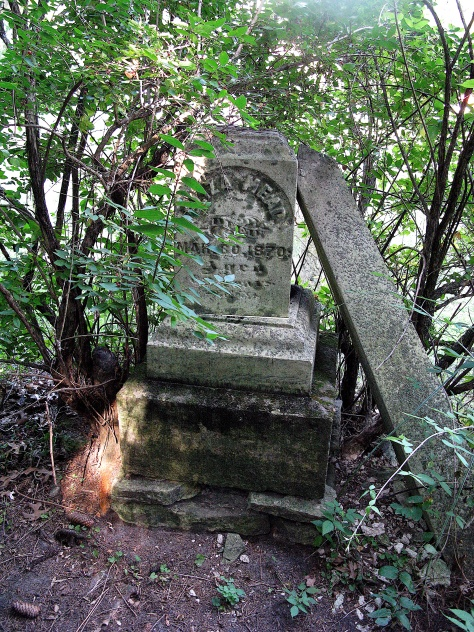 Broken tombstone of Eliza Mead, who died in 1870
