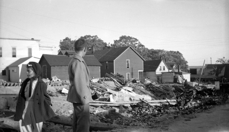 David D. Hanneman and his younger sister, Lavonne, survey damage from the 1945 Mauston fire.