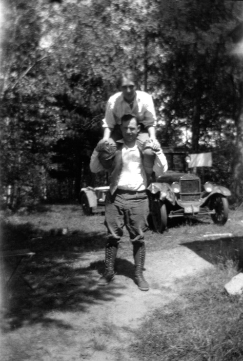 Ruby V. Hanneman rides on the shoulders of new husband Carl at their honeymoon camp at Hayward, Wisconsin.