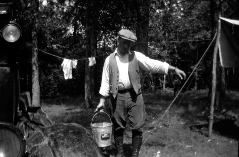 He could be carrying milk from the barn, but Carl F. Hanneman (1901-1982) is actually on a honeymoon camping trip in this July 1925 photo.