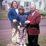 Marghi and Amy Hanneman stand on the carriage stone next to Grandpa Carl F. Hanneman in the 1970s.
