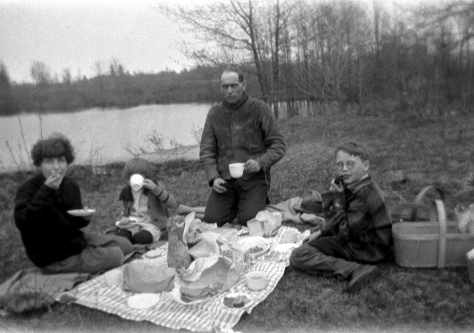 Walter Treutel picnics with children Nina, Elaine and Marvin, circa 1925. Behind the camera is Ruby (Treutel) Hanneman.