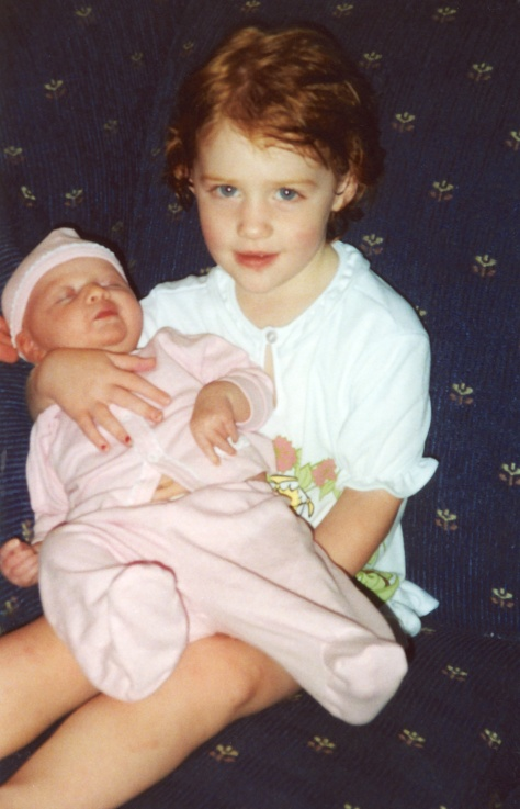 Samantha holds baby sister Ruby in July 1999.
