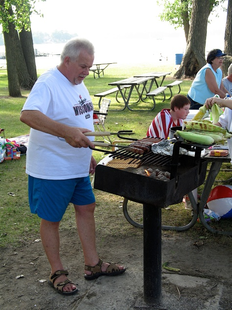 Ron in his favorite spot, working the grill.