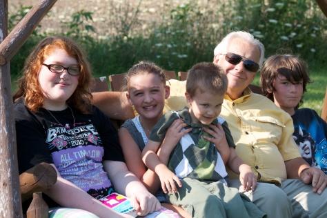Ron with grandchildren Samantha, Ruby, Josh and Geoffrey.