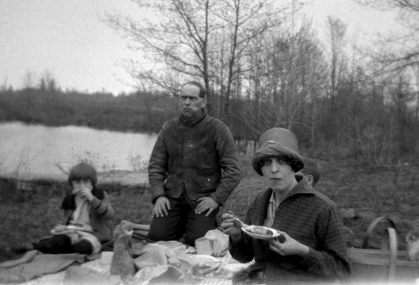 The Treutel family enjoys a picnic lunch on their property along the Hemlock Creek, circa 1924.
