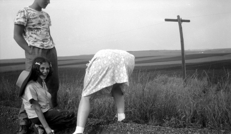 Lavonne Hanneman can't resist laughing as her mother Ruby bends down to pick up rocks on a trip to South Dakota in 1947.