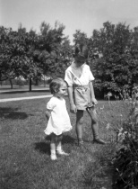 David D. Hanneman watches over his little sister, Lavonne, circa 1938.