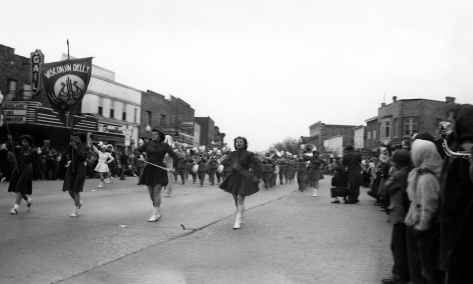 The Wisconsin Dells marching band parades down State Street in Mauston, circa 1942.