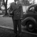 David D. Hanneman (1933-2007), a member of the Mauston High School Marching Band, poses outside his Mauston home in 1948. Hanneman, who later in life became mayor of Sun Prairie, Wis., played bass drum and trumpet.