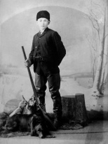 Frank Herman Albert Hanneman (1895-1947) of Grand Rapids, Wis., posed for this studio photo with a shotgun, ammunition belt and even a hunting dog. The photo was taken ca. 1909. Frank was the son of Carl Frederick Christian Hanneman (1866-1932) and Rosine B. H. Ostermann (1874-1918).
