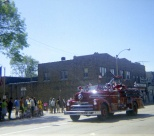 A fire truck heads down the parade route in Mauston in the late 1960s.