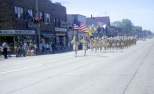 A marching band in downtown Mauston in the late 1960s.