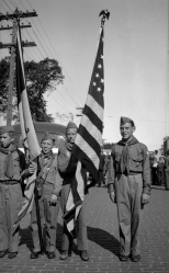 David D. Hanneman (at right) and other boy scouts before a parade in Mauston in the early 1940s.