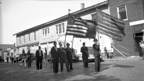 Members of the American Legion prepare to march in a parade in Mauston, circa 1942.