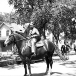 David D. Hanneman prepares to ride a horse in a Mauston parade, circa 1942.