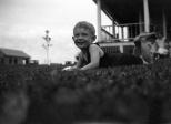 Donn G. Hanneman lounges outside his Grandpa Treutel's home in Vesper, Wisconsin, circa 1930.