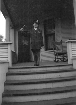 Donn G. Hanneman wears a convincing looking police uniform, perhaps a Halloween costume.