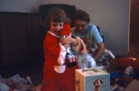 Looks like Laura Mulqueen Curzon got what she wanted for Christmas. In the background is Grandma Ruby Hanneman.