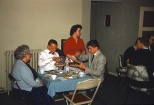 Looks like a dinner party at my parents house in Greenfield in the late 1950s.
