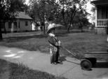 Donn G. Hanneman looks like a lonely cowpoke with his wagon, circa 1930.