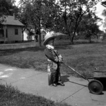 Donn G. Hanneman looks like a lonely cowpoke with his wagon, circa 1930.