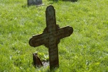 This iron cross is one of the more unusual monuments at Old Holy Cross Cemetery.