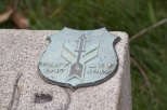 """Military marker designating a member of the 32nd """"Red Arrow"""" Division"""