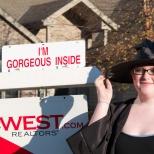 We just had to pose Samantha Hanneman with this sign on Halloween, circa 2010.