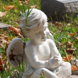 Cherubs often watch over the graves of little ones.