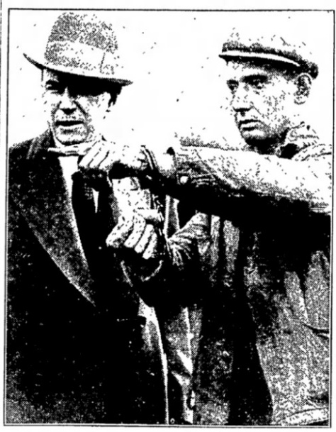 Otto Pech points out details of the murder scene to Lester Laird, chief of the Cook County highway police.