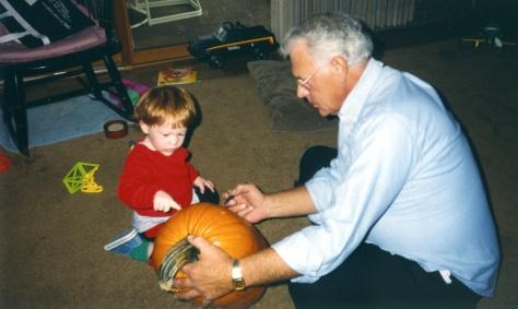 Son Stevie watches Grandpa Dave Hanneman prepare to carve, circa 1993.
