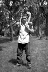 David D. Hanneman on the shoulders of brother Donn.