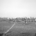 Game action from this 1947 football contest at Mauston.