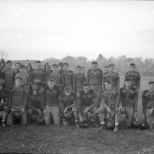 Another group shot of the team. On this one, Dave Hanneman (back row left, second from coach) has his tongue sticking out. Front and center (91) is Dick Hale.