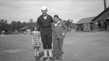 Donn G. Hanneman (center) in his U.S. Navy uniform, with sister Lavonne and brother David in 1944.