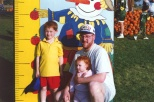 Dad with Stevie and Samantha Hanneman at Swan's Pumpkin Farm, 1997.