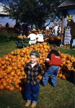 Stevie Hanneman poses before the pumpkin pile at Swan's Pumpkin Farm, circa 1995.