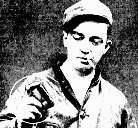 Railroad conductor George Kerwin holds an expended shotgun shell he found about 1 mile from the murder scene.