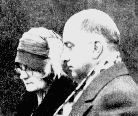 Alice and Harry Leng watch in stunned silence as the casket of their only child is blessed for burial.