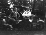 Carl F. Hanneman (at right) leans on his Ford near the camp where he and bride Ruby spent their honeymoon.