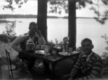 Carl F. Hanneman and an unidentified boy at the Hanneman picnic table.