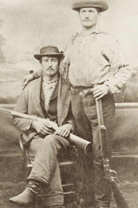 "William Gaulke (standing) with his arm around William F. Cody, who later went on to fame as ""Buffalo Bill."""