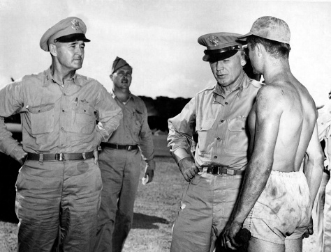 "Lt. Gen. Barney M. Giles (left) sent a letter to Edward Mulqueen thanking him for donating a knife to the war effort. Here, he and Gen. Henry H. ""Hap"" Arnold speak with S/Sgt. Leo Fliess of Sturtevant, Wis., on Guam in 1945. (Army Air Force Photo)"