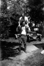 For their honeymoon in July 1925, Carl F. Hanneman (1901-1982) and Ruby Viola (nee: Treutel) Hanneman (1904-1977) took a camping trip to Wisconsin's north woods. The couple are pictured at a camp site near Hayward, Wis. They were married July 14, 1925 at Vesper, Wis.