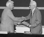 John Bogle (right) receives an award presented by Mayor Dave Hanneman. (Sun Prairie Star Photo)
