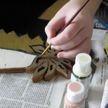 Samantha J. Hanneman retouches details on the Baby Jesus figure built by her grandfather, David. D. Hanneman.