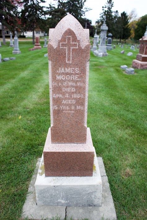 The grave marker of James Moore at Sacred Hearts of Jesus and Mary Catholic Cemetery in Sun Prairie, Wisconsin.