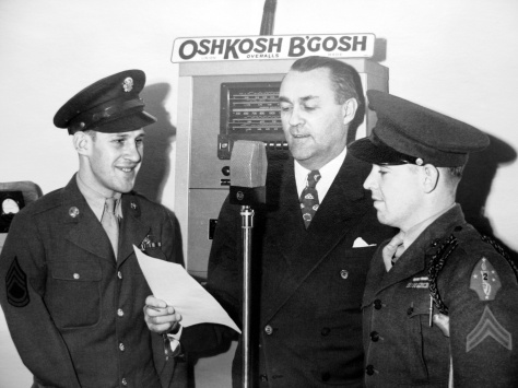 Sgt. Louis C. Koth (left) and Marine Cpl. Earl J. Mulqueen Jr. are introduced at the Oshkosh B'Gosh Inc. bond rally on November 30, 1944.