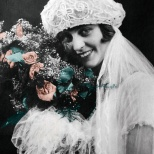 The bridal photo, hand retouched to restore color to the roses.